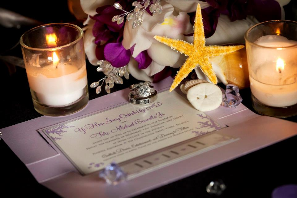 Purple orchids and soft lavender tones were found throughout the wedding, including the invitation suite adorned with coral.