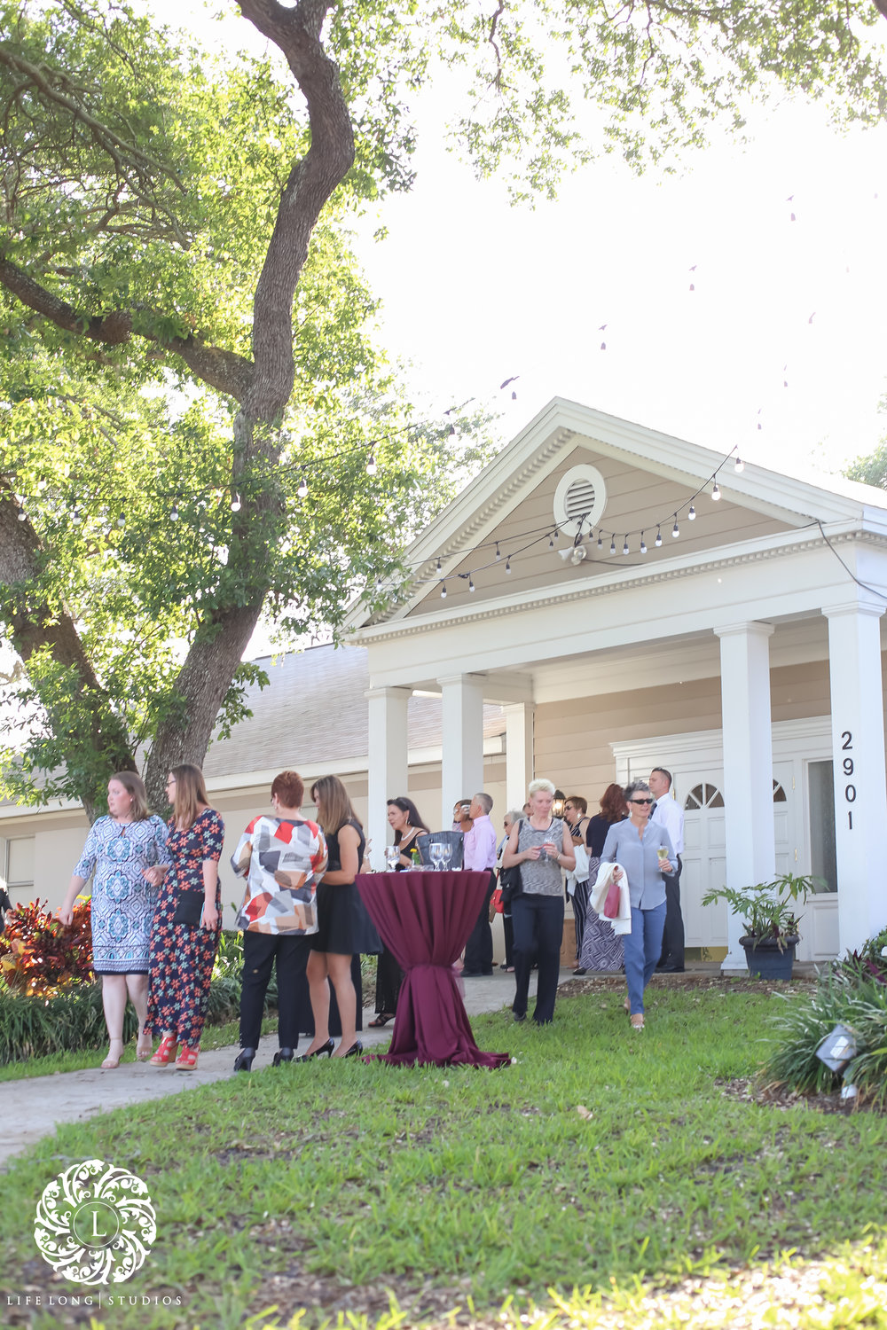 The cocktail hour was held on the lawn of the Tampa Woman's Club, and was adorned wth overhead Edison lights.