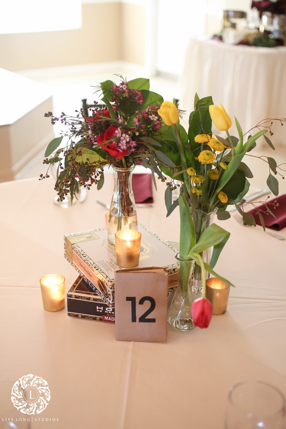 Vintage books were wrapped in Kraft paper and used as unique table number displays.