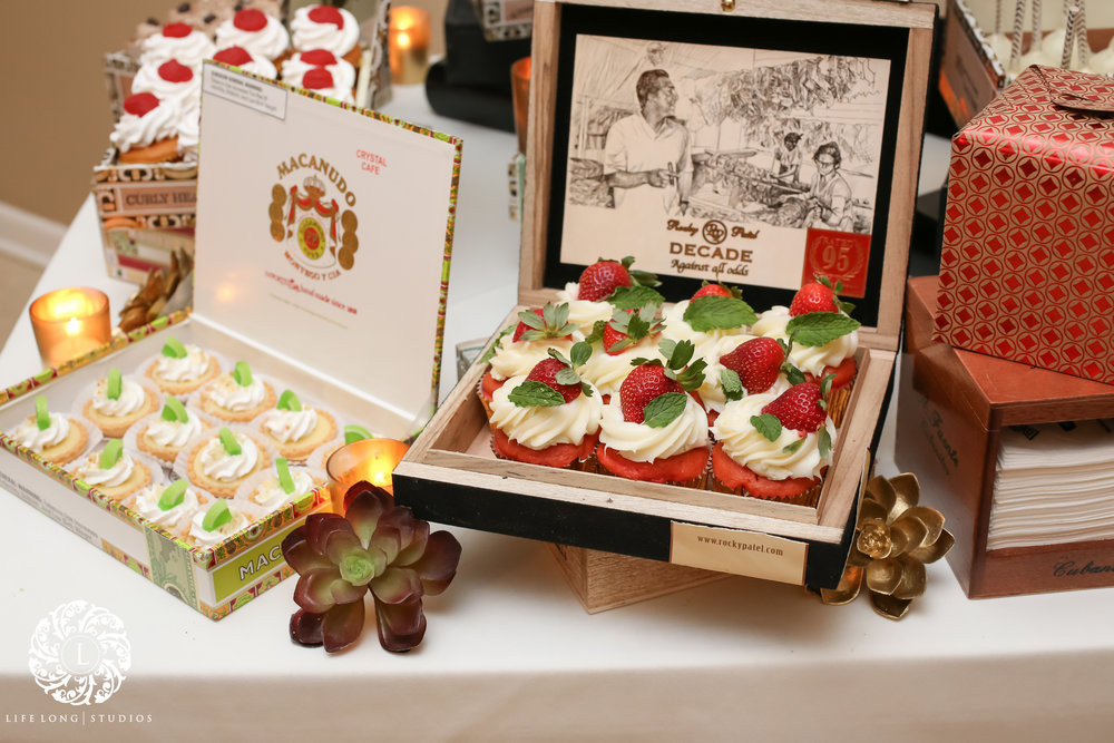 Vintage cigar boxes also made an appearance on the dessert table, holding Tampa-themed desserts like Plant City strawberry and guava cupcakes, and mini key lime pies.