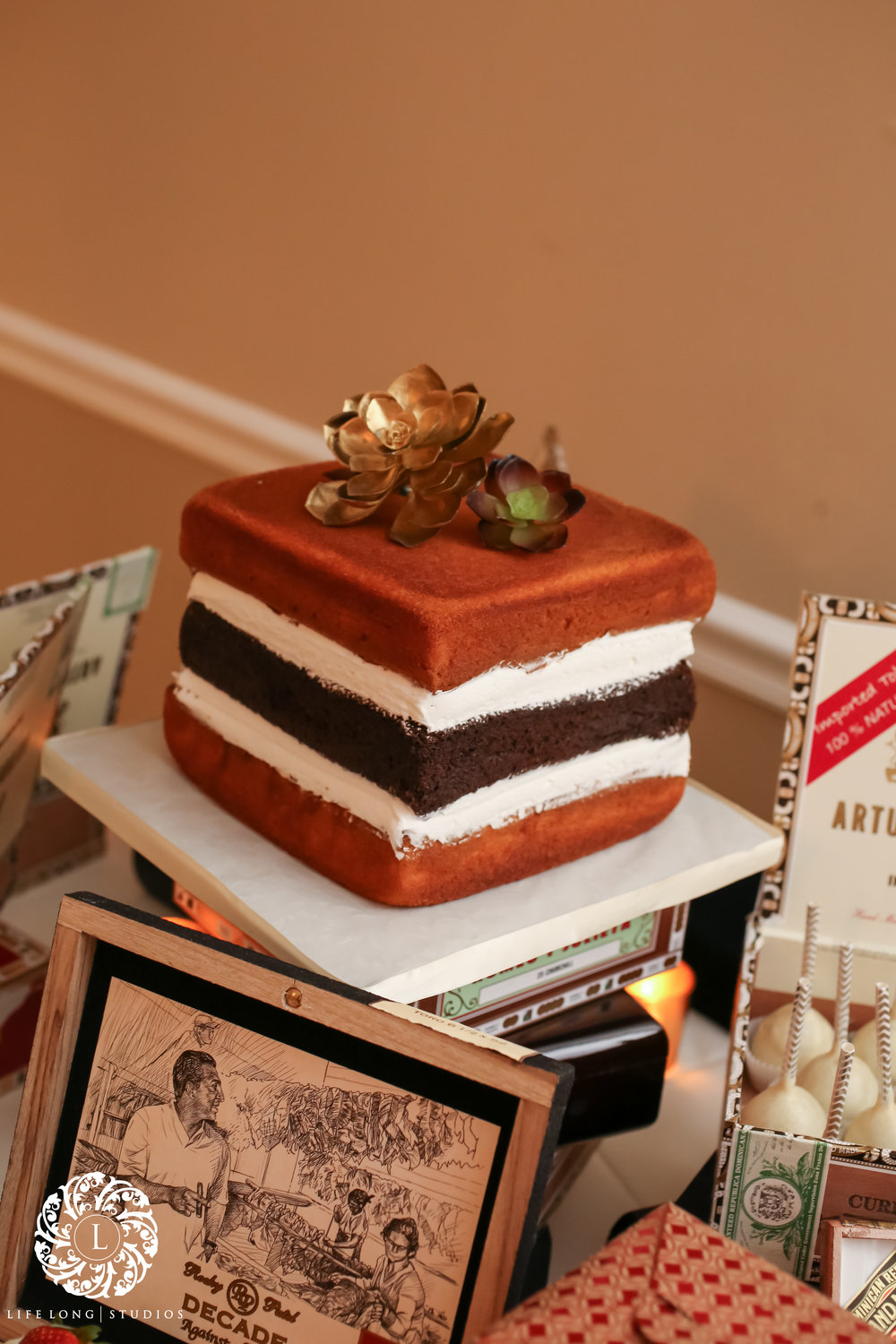 A square naked cake was at the heart of the dessert table, inspired by cigar boxes and made by a Tampa favorite, Alessi's Bakery!