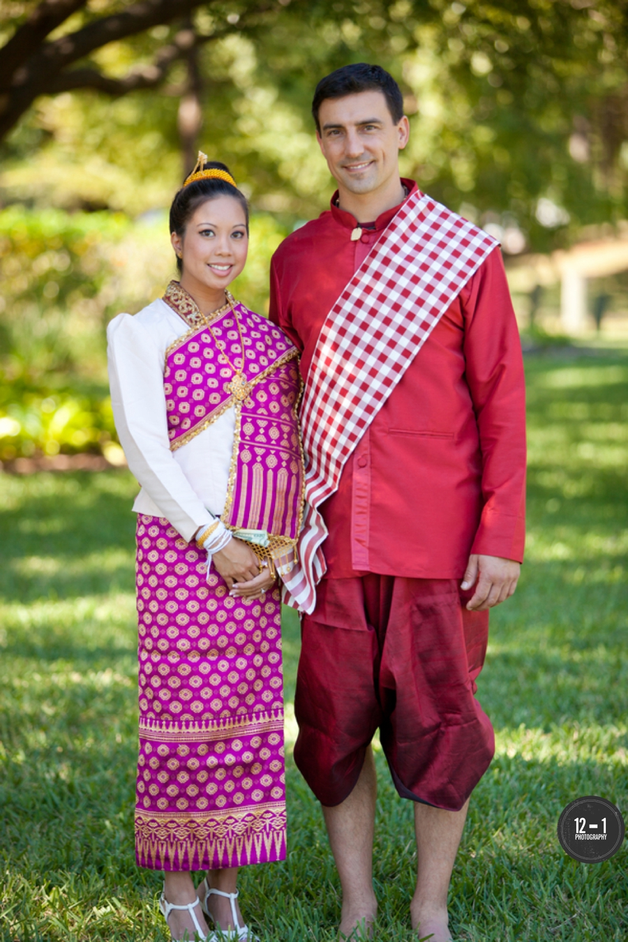 The bride and groom combined cultures in their traditional Laotian attire of bridal silk sinh and groom silk salong.