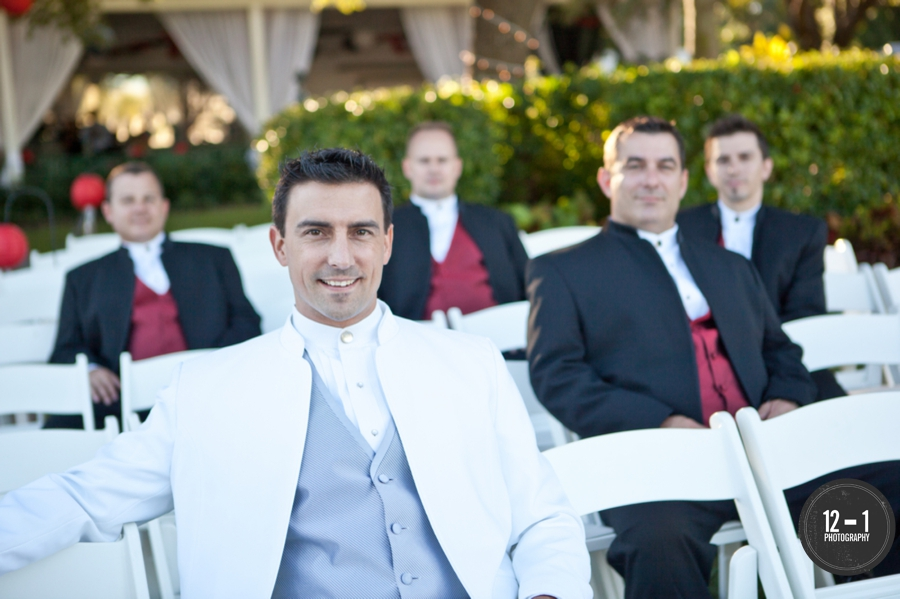 The groom and groomsmen kept a Laotion influence in their attire for the Christian ceremony, wearing mandarin collared shirts and suit jackets.