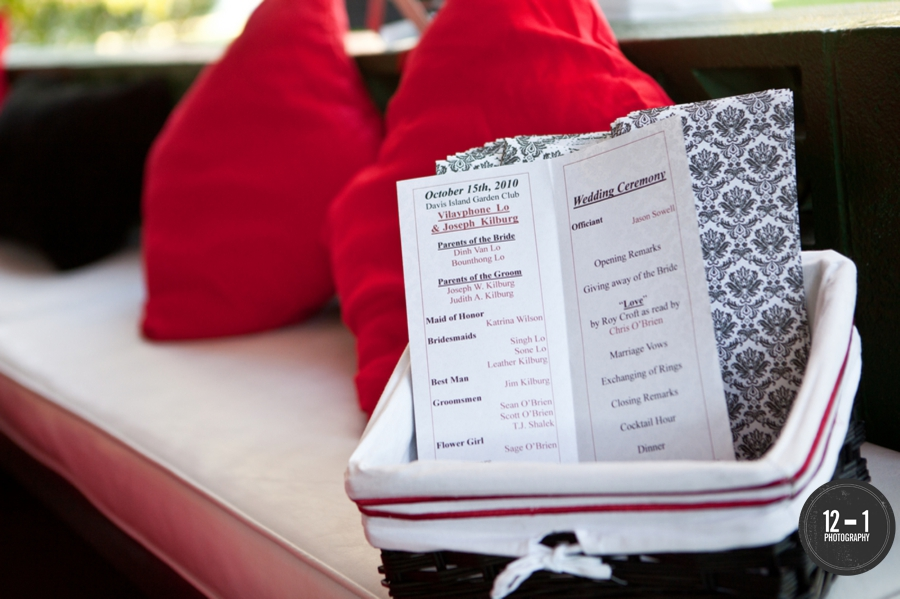 Booklet style programs featured a black and white damask design, with pops of red to compliment the wedding colors and decor.