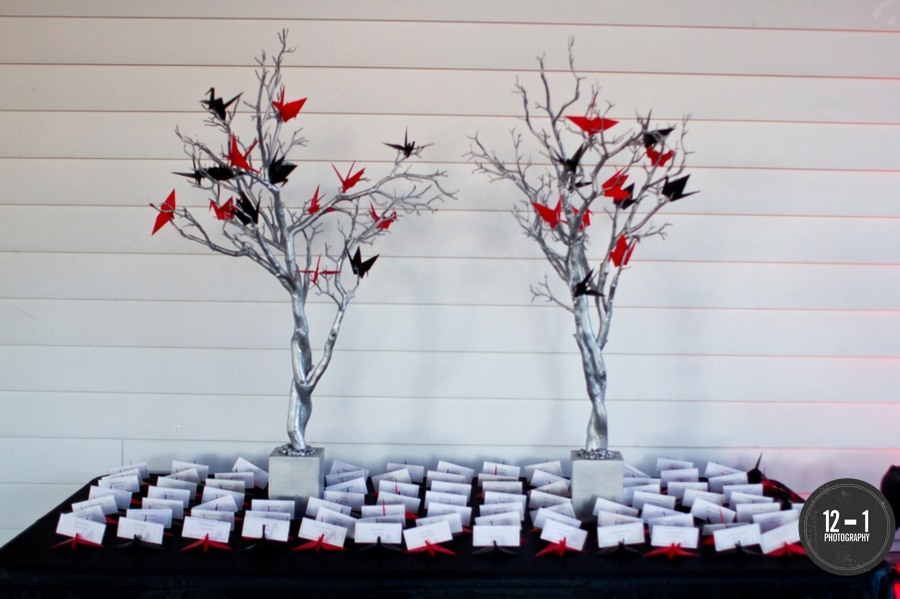 The escort card display featured silver Manzanita trees with paper cranes.