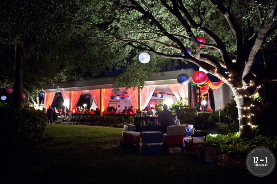 Uplighting and paper lanterns transformed the outdoor veranda into a Laotion infused party.