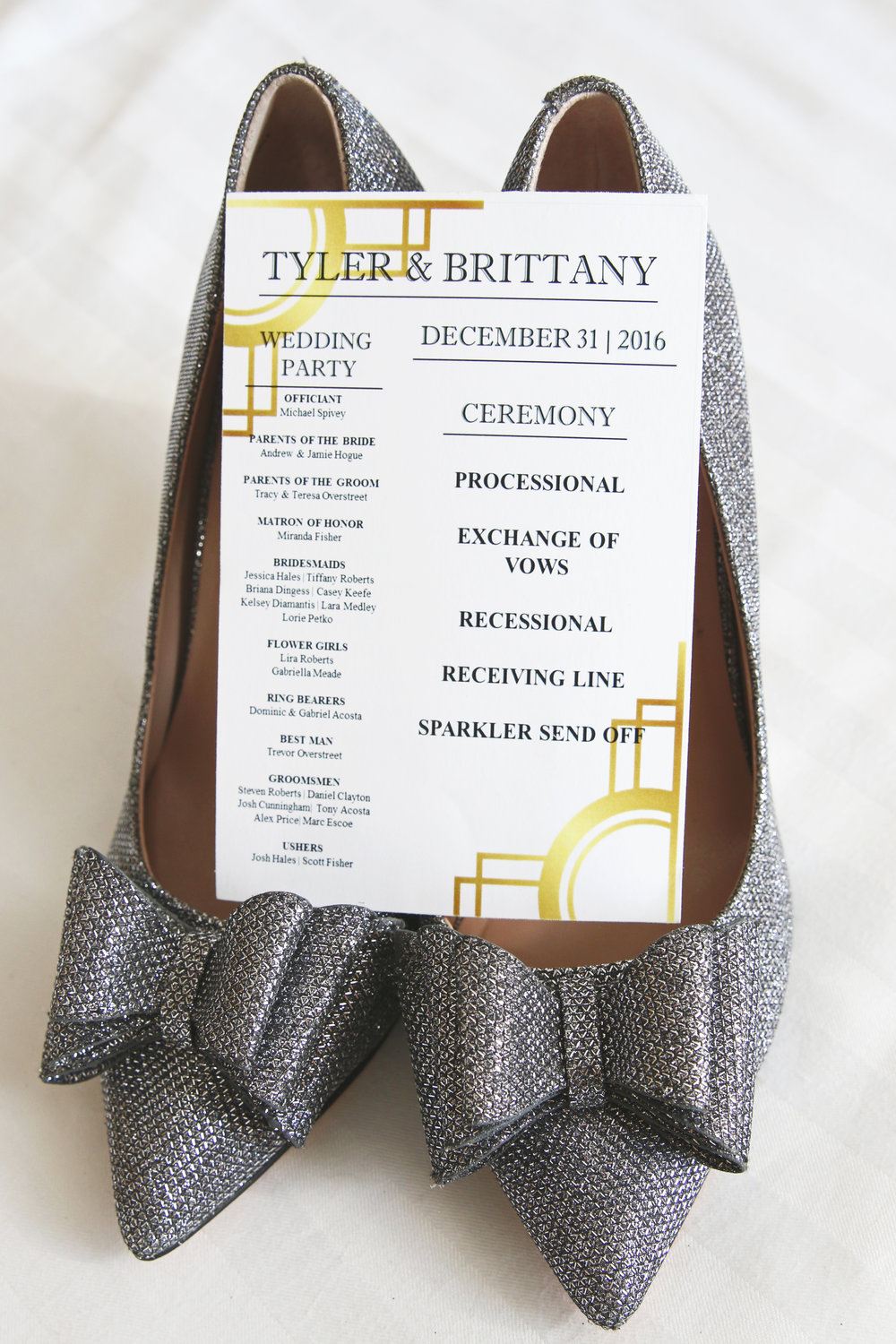 The wedding programs sported a clean Art Deco design that paired very well with the bride's sparkly shoes perfect for a New Years affair!