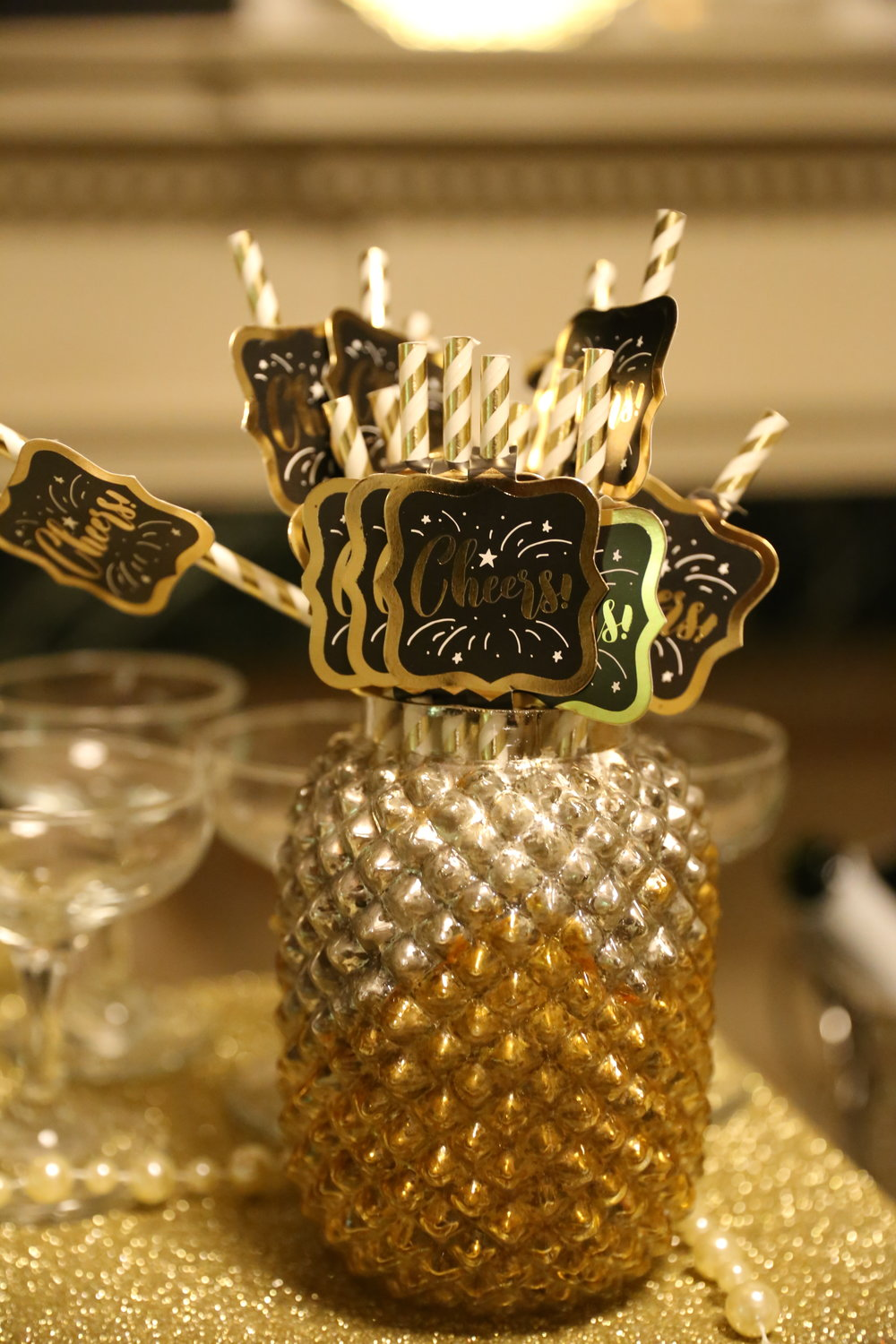 Adorable decor pieces like gold paper straws and strings of pearls decorated the 'Bubbly Bar'.