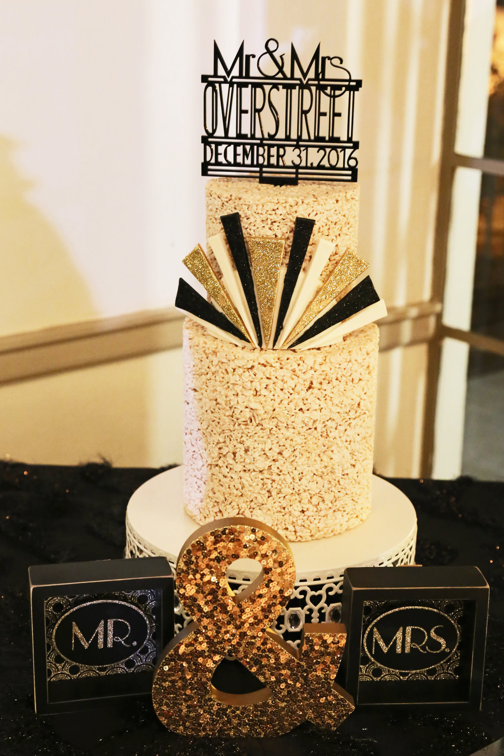 The unique wedding cake was created with crisp rice cereal and featured an art-deco design.
