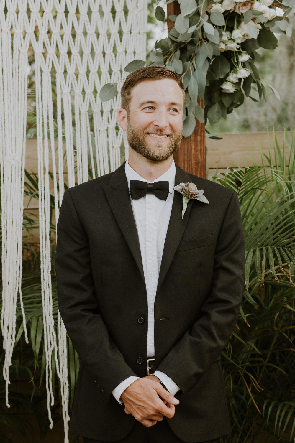 Drew threw on a sharp black suit jacket and donned a boutonniere to instantly look the part of the groom.