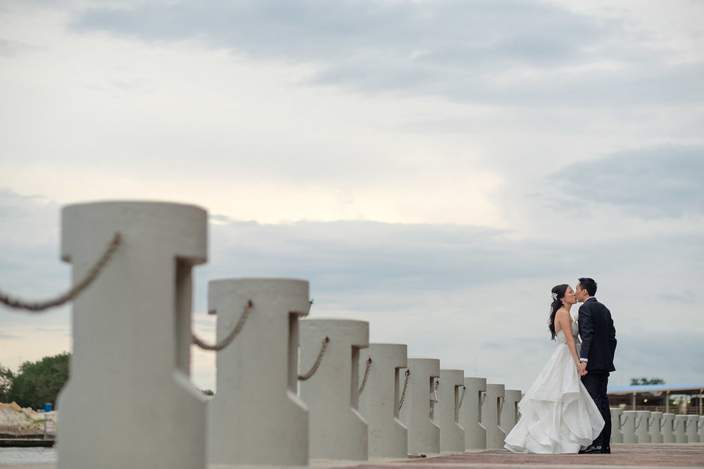 The couple posed in Downtown Tampa beneath a cloud streaked sky.