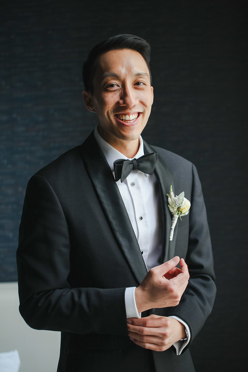 The groom wore a sharp black and white tux (and a look of someone truly elated!)