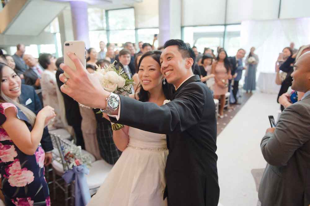 After being pronounced husband and wife the couple were showered with rose petals before posing for a selfie while walking down the aisle (one look at this photo and you can feel their joy!)