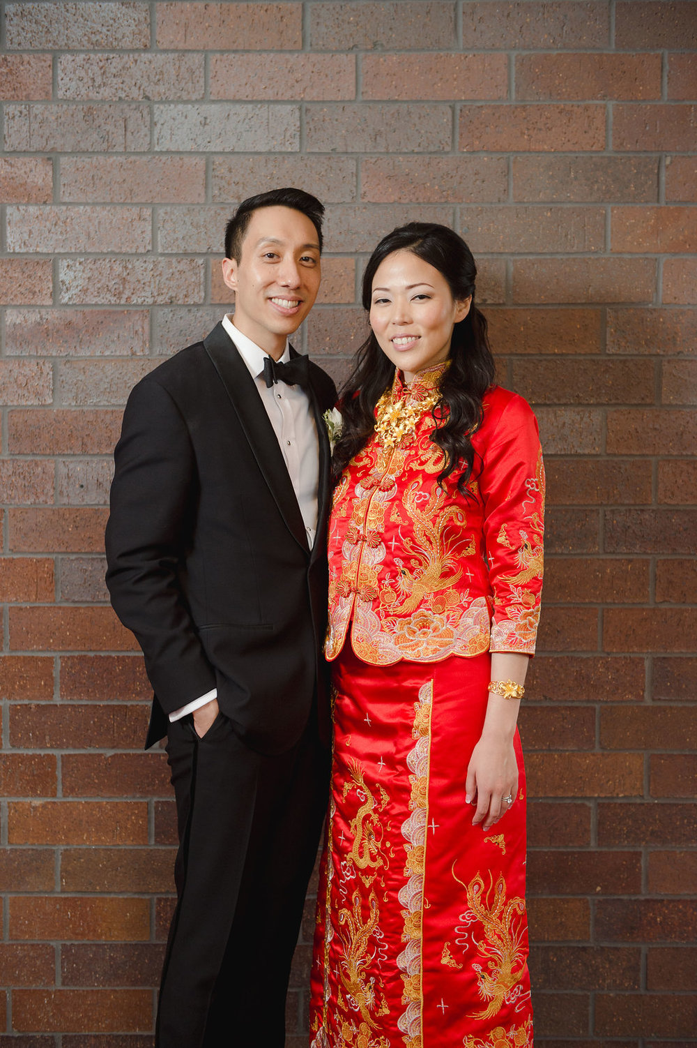 The bride changed into stunning red and gold traditional Chinese garb for the tea ceremony.