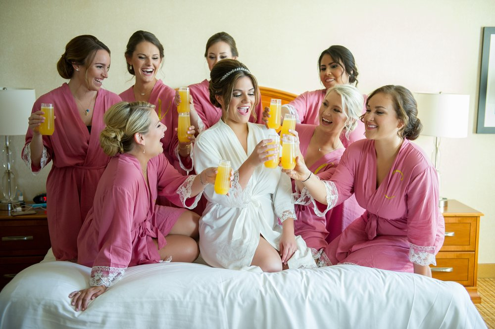 The girls donned matching pink robes with delicate lace details and gold monograms.