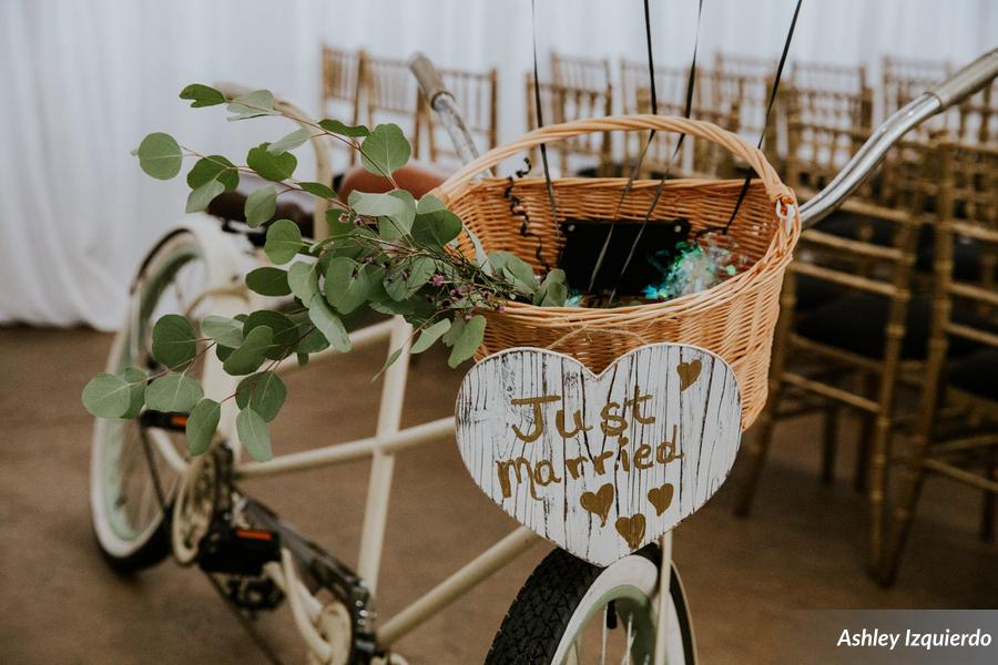 For a unique getaway, the couple bought a tandem bike, and attached a sweet basket and 'Just Married' sign.