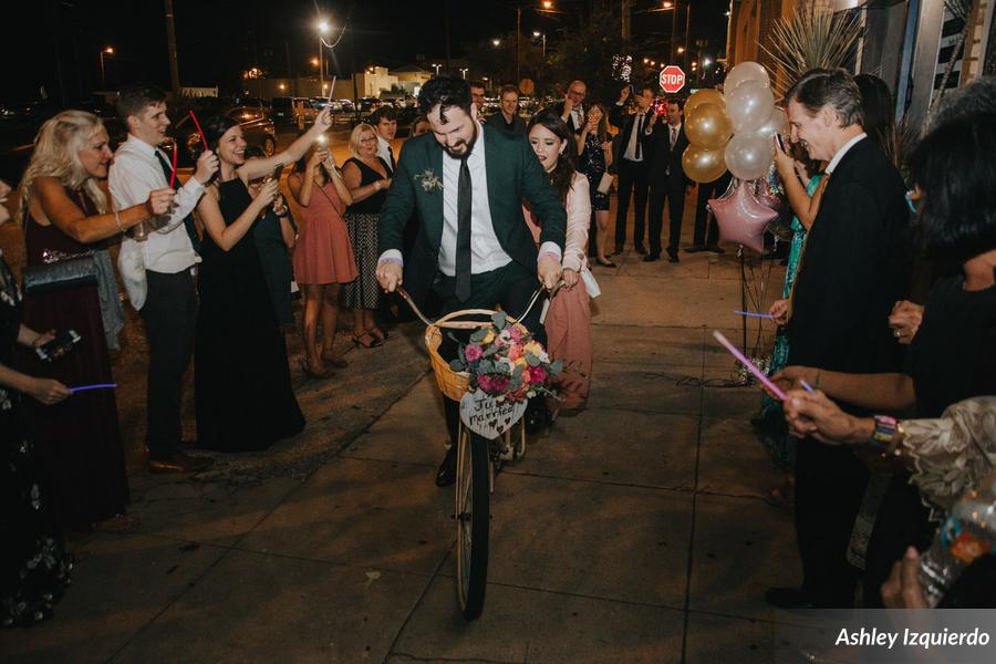 The couple was sent off on their tandem bike, surrounded by waving glowsticks!
