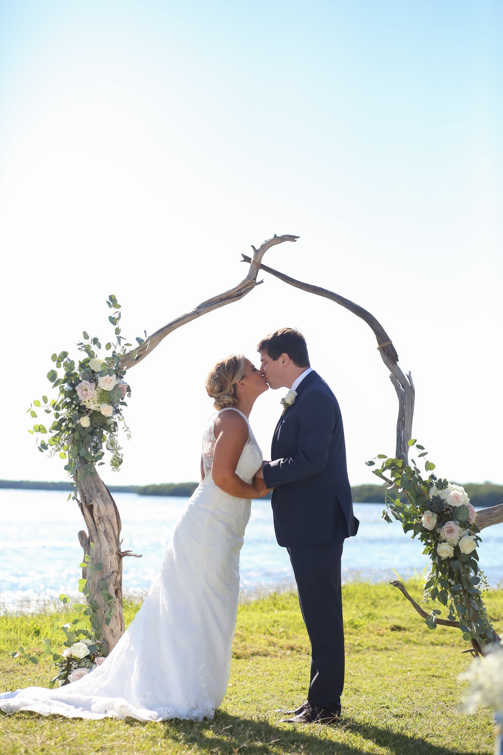 The couple shared a first kiss, overlooking the stunning waterfront view.
