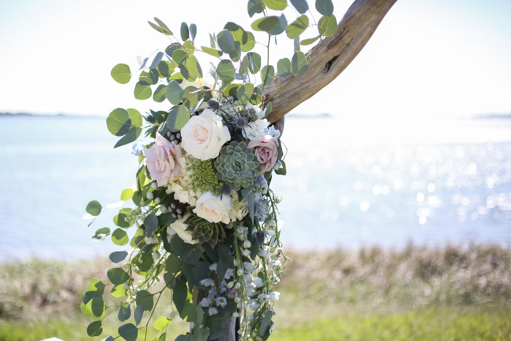 Organic-style floral arrangements boasted quicksand roses, lisianthus, stock, eucalyptus, blue thistle, hydrangea, queen anne's lace, dusty miller, and succulents,
