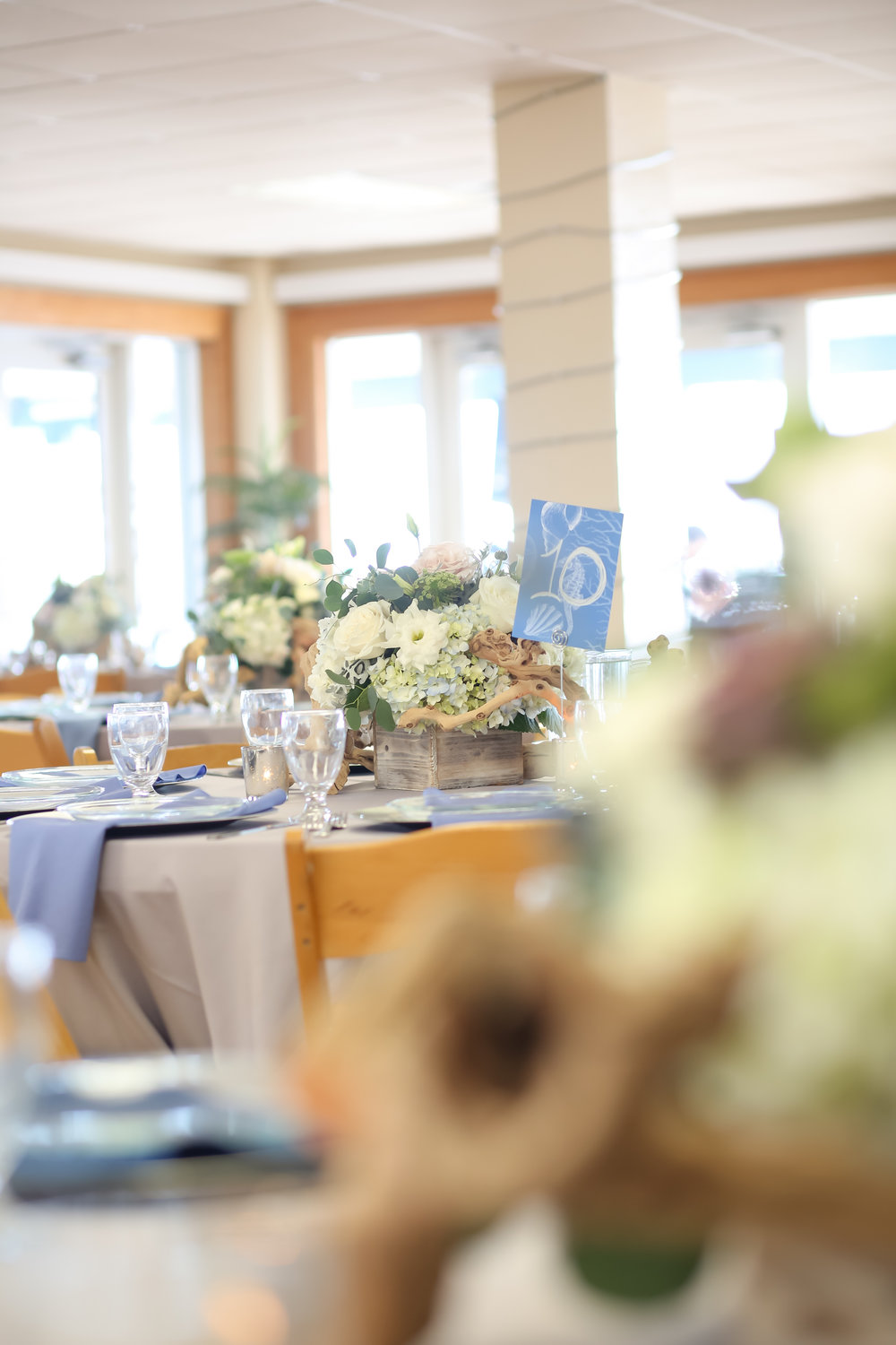 A coastal chic motif incorporating sunbleached wood boxes gave a nod to the bride's rustic Southern style.