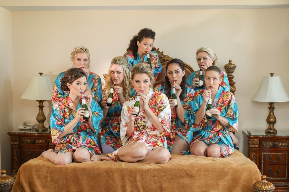 The bridal party's silk robes featured colorful florals with both tropical and autumnal vibes.