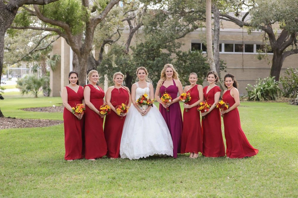 Bridesmaids wore dresses in bright fall shades which accented the colors found throughout the wedding.