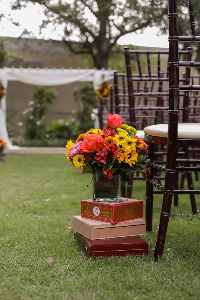 Bright florals and vintage style cigar boxes lined the aisle.