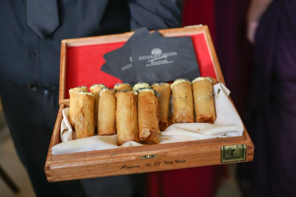 Guests enjoyed creative Florida-Cuban fusion cuisine, including passed 'Cuban cigars' of puff pastry filled with traditional Cuban sandwich ingredients studded with mustard and seasoning to resemble cigars in a cigar box.