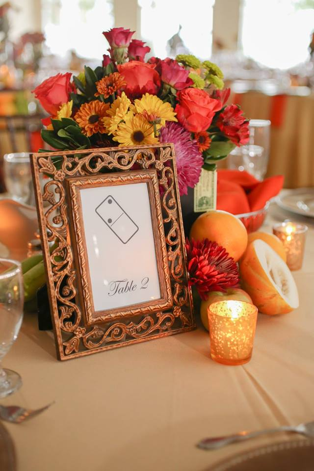Tropical fruit was incorporated throughout the collection of cigar box centerpieces.