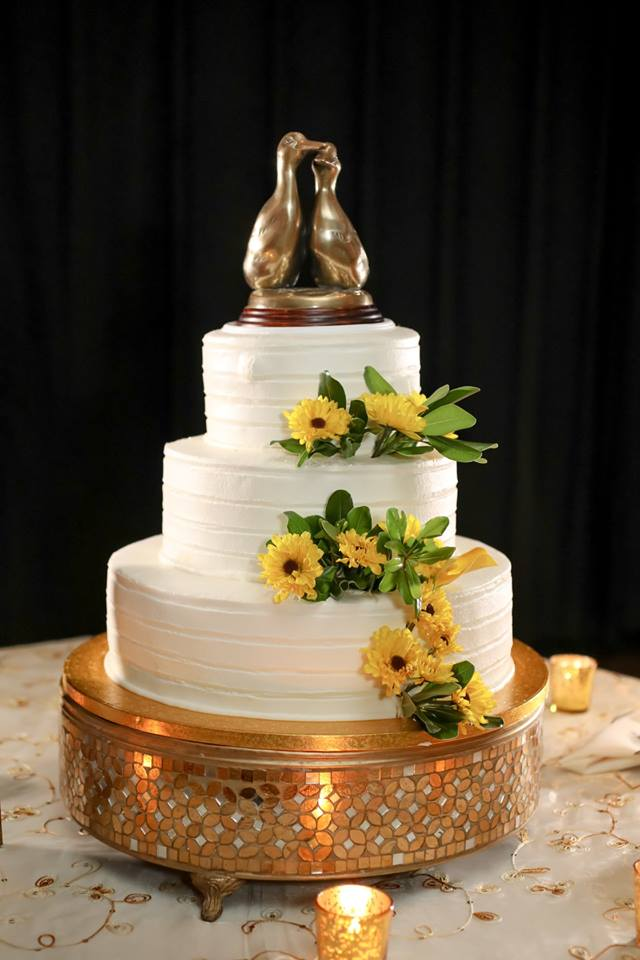 The cake featured flavor combos like Vanilla Key Lime, Hummingbird with Rum Pecan, and Guava Cream Cheese - topped off with a pair of adorable brass ducks in honor of the Peabody hotel in Memphis where the couple became engaged after the daily ducks parade through the lobby!