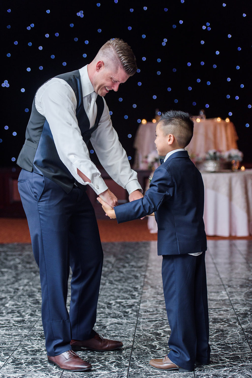 One of the sweetest moments was when the bride's son and ringbearer requested a special song from the DJ and asked his new Dad, Eric, to have a special dance with him - there wasn't a dry eye in the house!