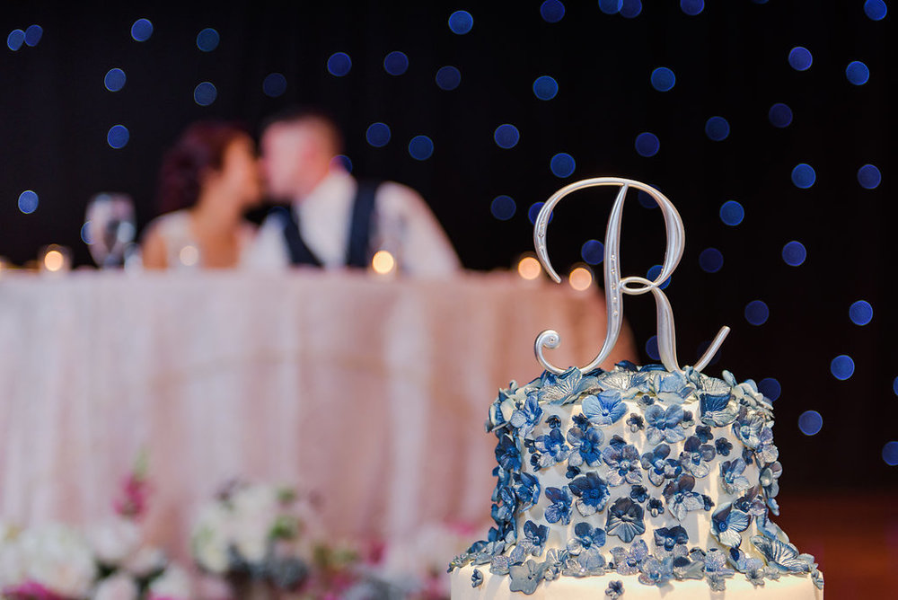 The silver cake accessories along with the blue sugared flowers incorporated the color scheme found throughout the rest of the wedding.