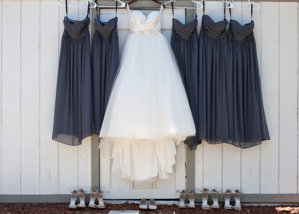 The bride wore a timeless ballgown and her bridesmaids donned chic charcoal chiffon dresses.