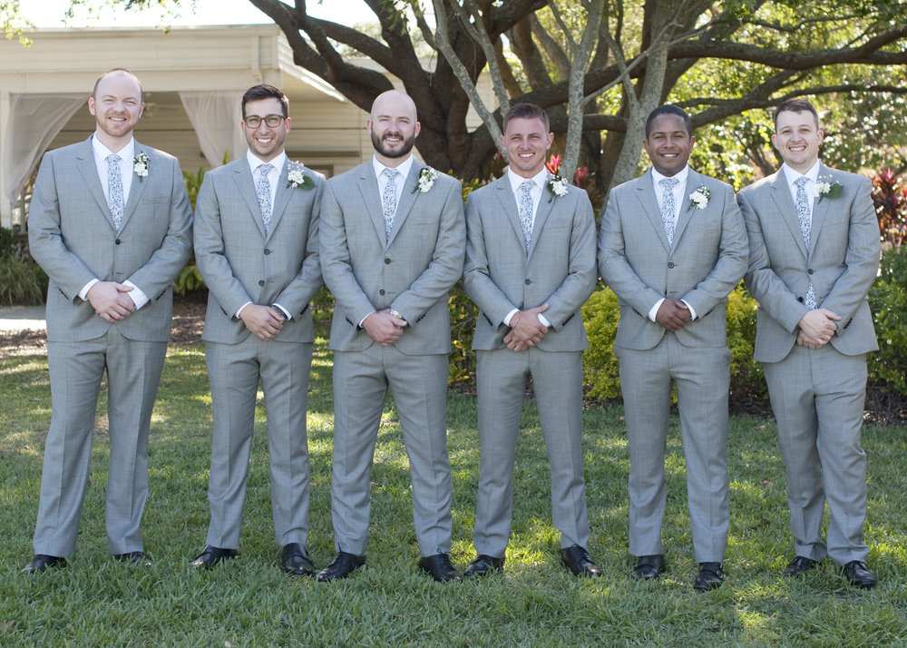 Gentlemen looked dapper in their crisp light grey suits.