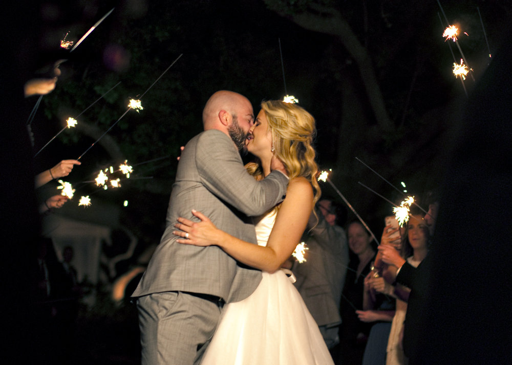 The couple departed beneath a sparkler sendoff!
