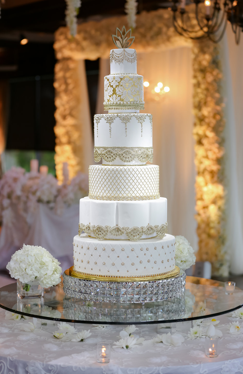 And can we just talk about this cake?! The gold accents and crystal details commanded attention under the pinspot.