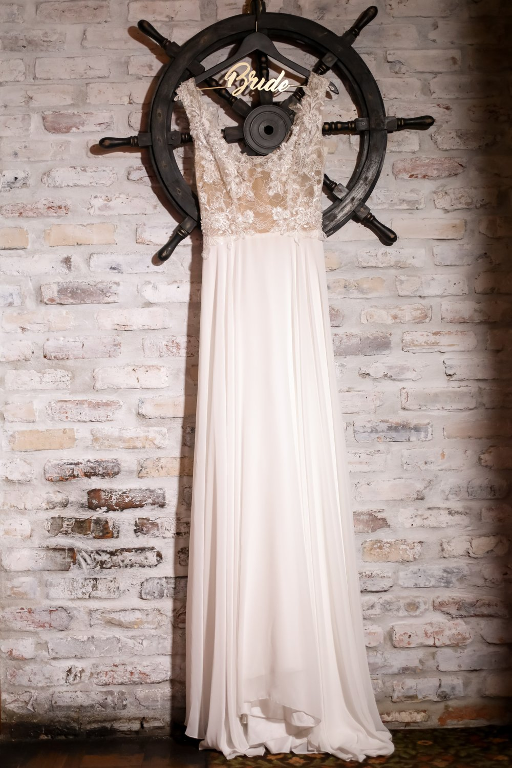 A sweet and simple gown was chosen for the waterfront nuptials but featured elegant illusion lace details.