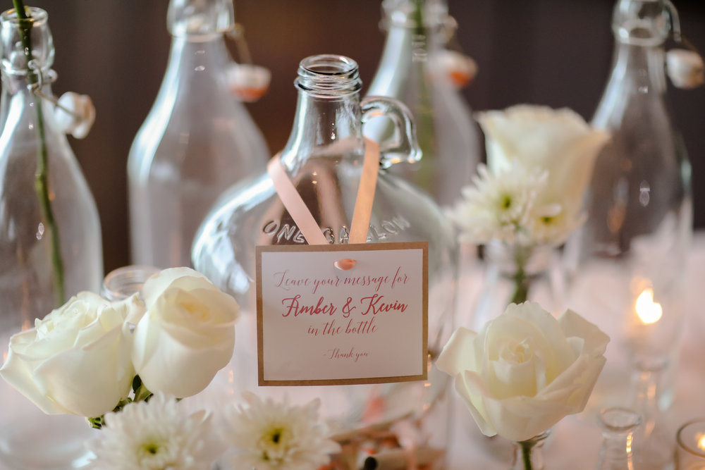 Fun coastal details, like a message-in-a-bottle guestbook, were incorporated throughout.