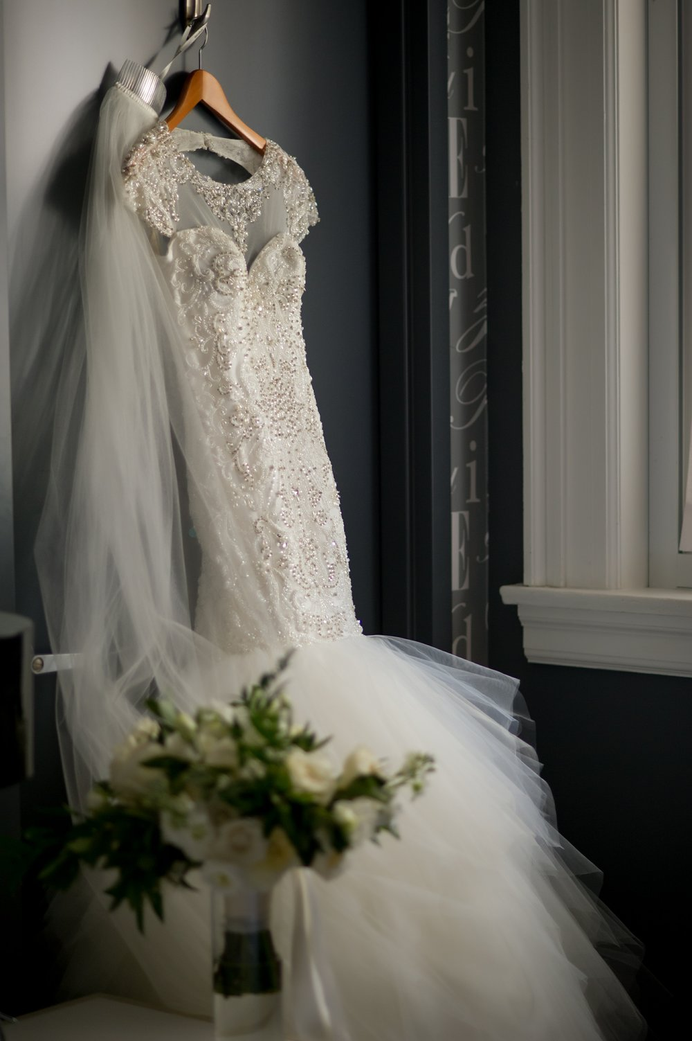 The bride wore a stunning bead embellished, lace and tule mermaid style gown.