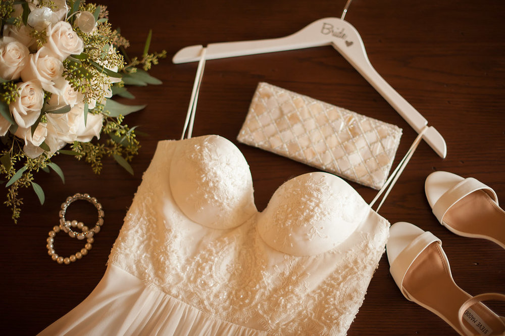 A beaded dress with delicate straps and light accessories are the perfect compliment to the natural beauty of this island wedding.