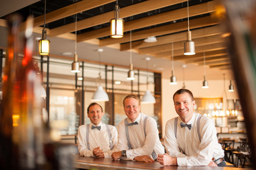 The gentlemen relax at the bar before the ceremony begins.