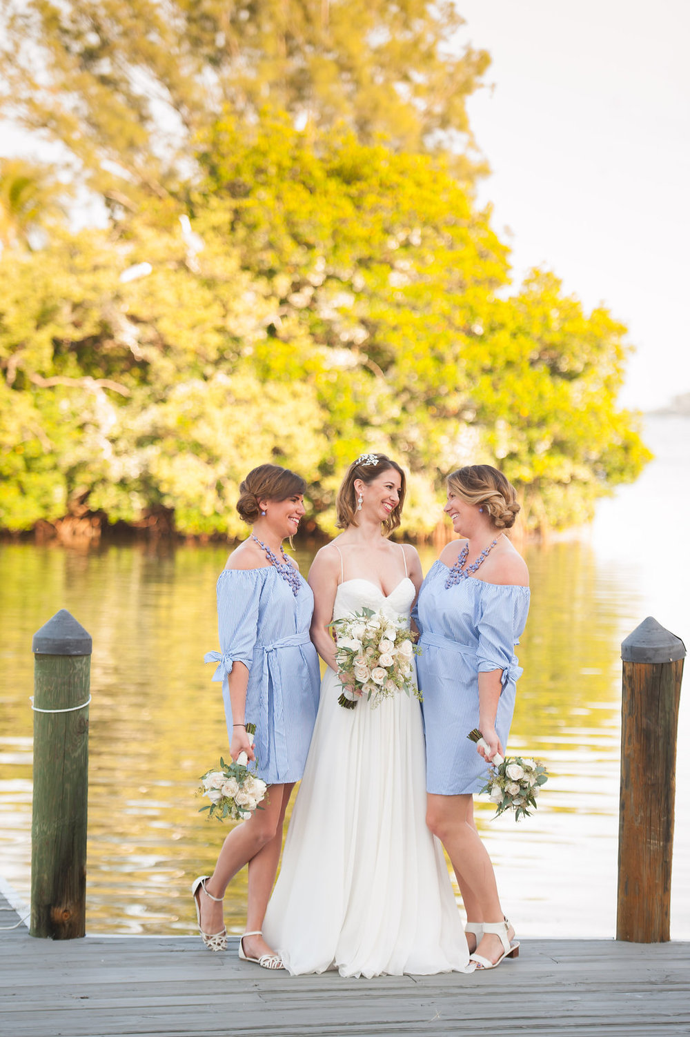 The bridesmaids wore short, striped dresses to incorporate a fun and relaxed searsucker vibe.