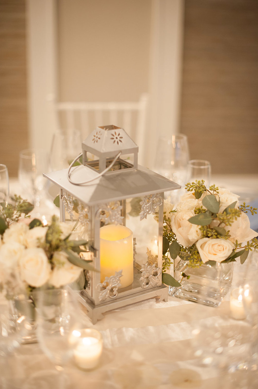 Lanterns and florals transferred from the ceremony adorned some of the tables.