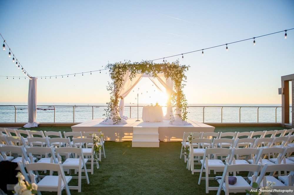 The ceremony was an evening celebration on the lawn overlooking the ocean.