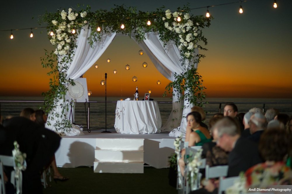 The stunning vine-clad chuppah, which symbolizes the home the couple will build together, was a stunning focal pooint set against the fading sunset before the evening ceremony began.
