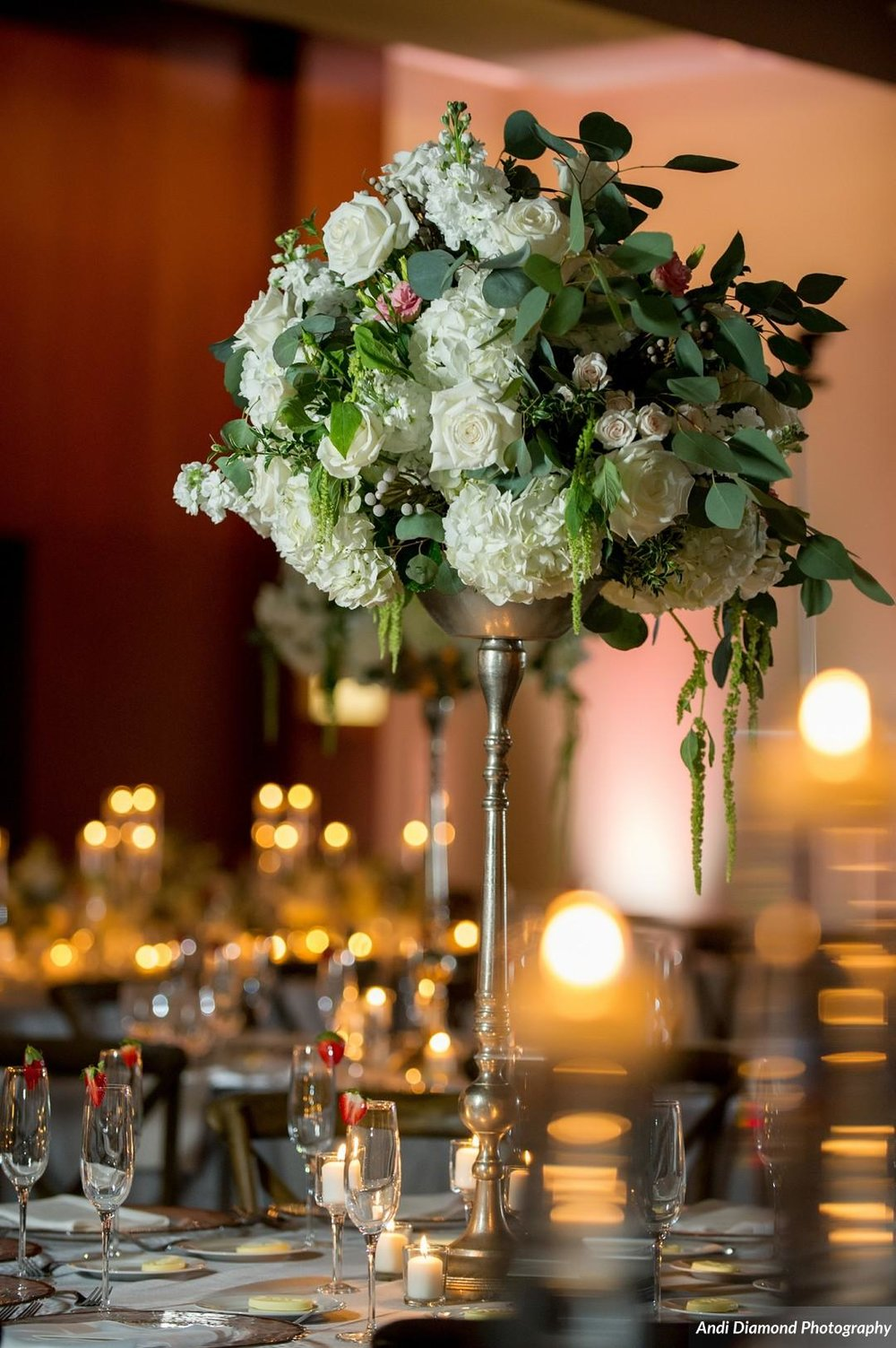 A mix of towering florals and candlelight with the natural color scheme created a perfect blend of sophistication and simplicity.
