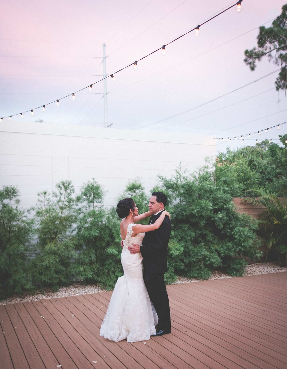 Initially worried about inclemental weather for their outdoor ceremony, the resulting sky full of pinks and purples proved to be beautiful surprise that complimented the blush colors found in the reception.