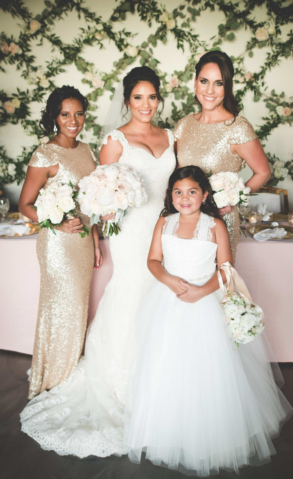 Bridesmaids glittered in rose-gold sequined gowns and the flower girl looked precious in white lace and tulle.