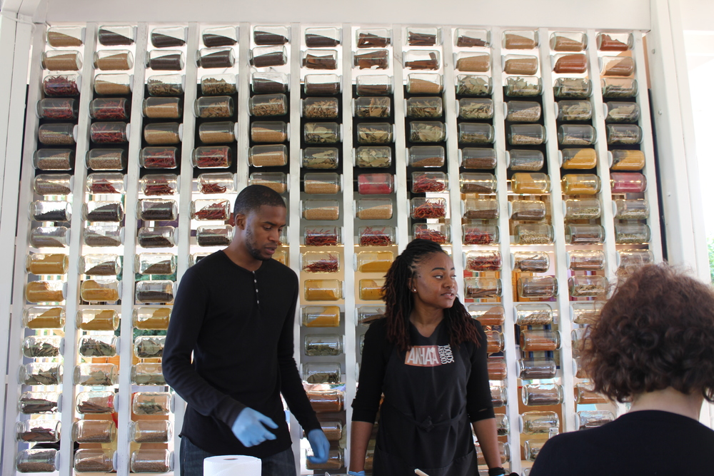The Akhaya team for the day and the amazing spice walls of The Spice Exchange