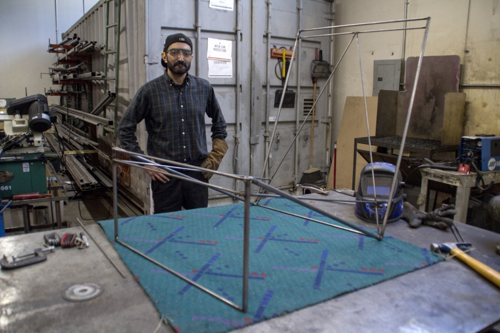 Artist Ivan Salcido works on his PDX Carpet Sling Back chair